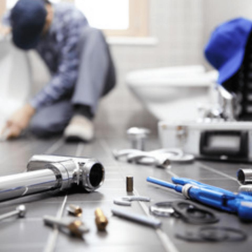 Plumber with plumbing supplies
