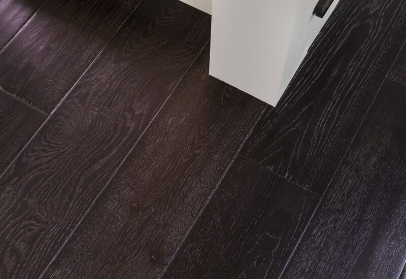Dark plank flooring in Vancouver, CN from All Surfaces