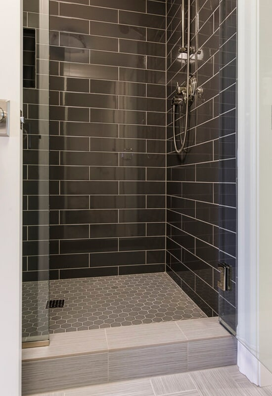 Black subway tile shower in Lake Oswego, OR from All Surfaces