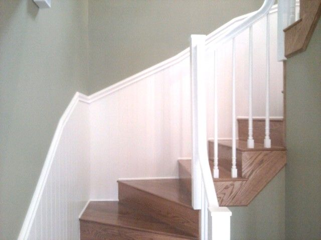Hardwood stairway with white banister in Nashua, NH from ADF Flooring LLC