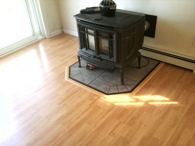 Tile flooring under wood burning stove in Nashua, NH from ADF Flooring LLC