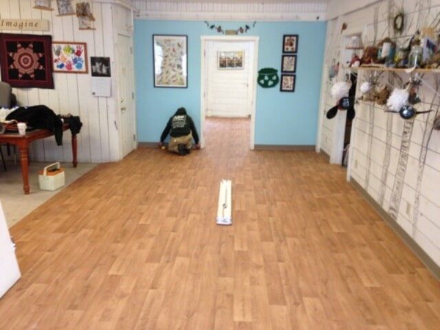 Installing wood look flooring in a commercial space in Plymouth, NH from ADF Flooring LLC