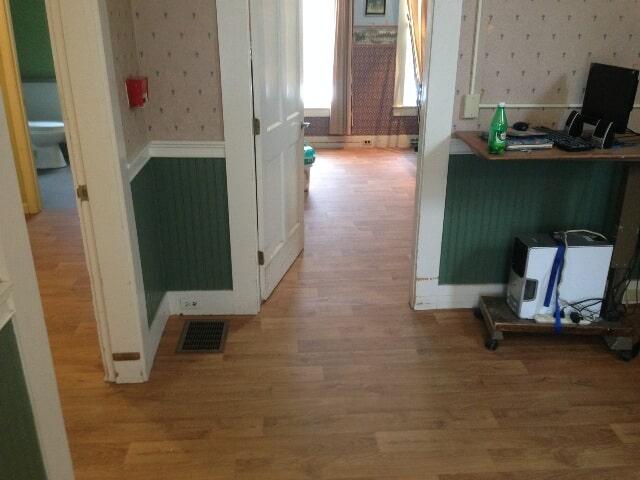 Medium tone wood look commercial flooring in Plymouth, NH from ADF Flooring LLC