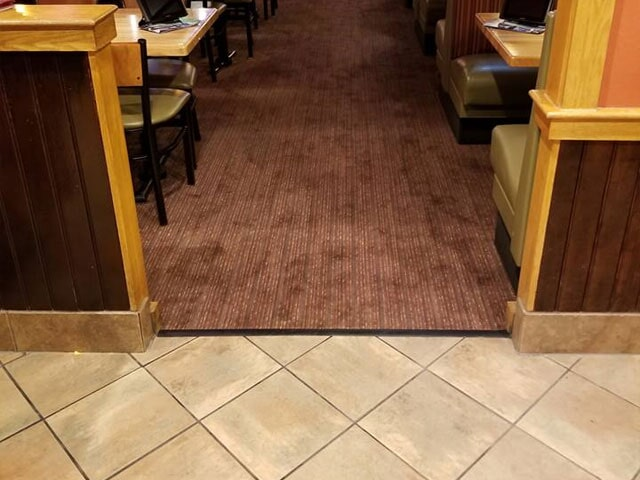 Commercial tile to carpet transition in Berlin, NH from ADF Flooring LLC