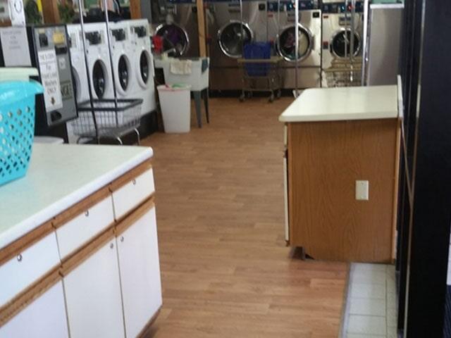 Laundromat flooring installation in Manchester, NH from ADF Flooring LLC