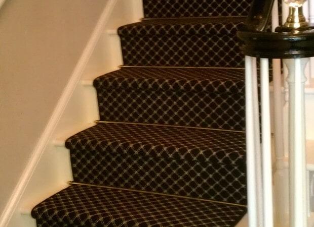 Dark carpeted stairway in Belmont, NC from Hall's Flooring