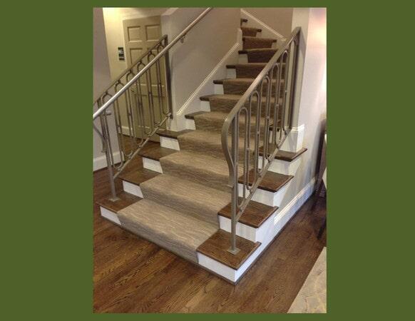 Sleek carpet runner on hardwood stairs in Pineville, NC from Hall's Flooring