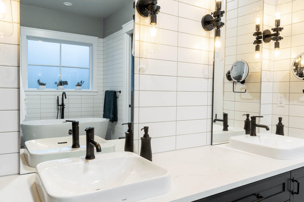 Bath remodel with black hardware in Portland, OR from All Surfaces