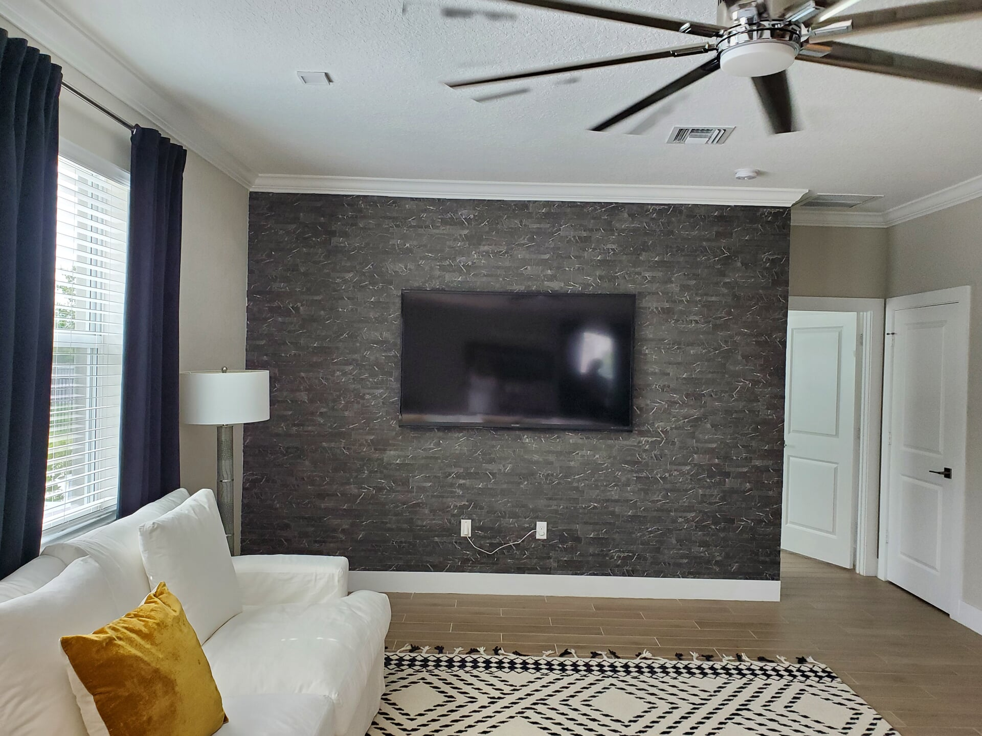 Tesoro Marmi Black was used in this living room accent wall project we did in Palm City, FL