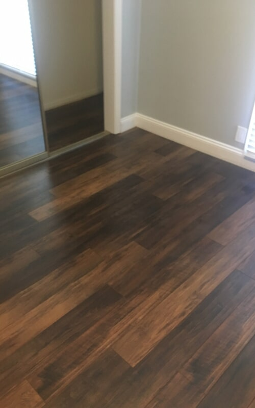 Dark flooring remodel in Brea, CA from Triple A Flooring Inc