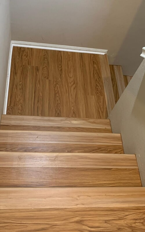 Classic hardwood stairway in Downey, CA from Triple A Flooring Inc