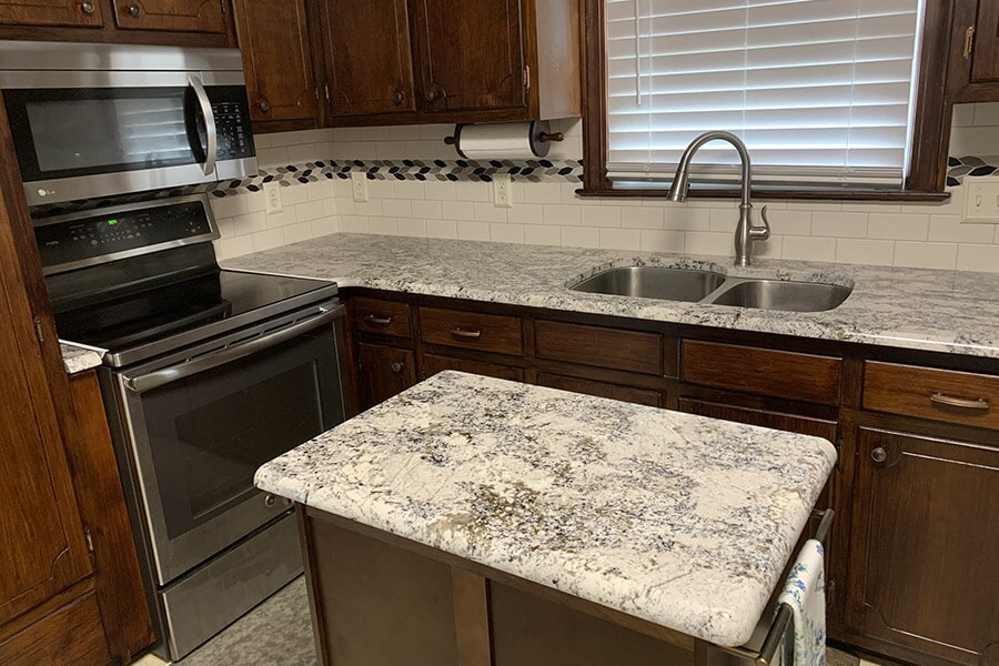 Kitchen and island countertop installation Natural stone countertops in Wilson, NC from Richie Ballance Flooring & Tile