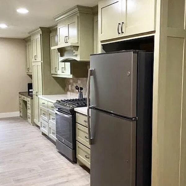 Beautiful light green cabinetry in Port Arthur, TX from Odile's Fine Flooring & Design