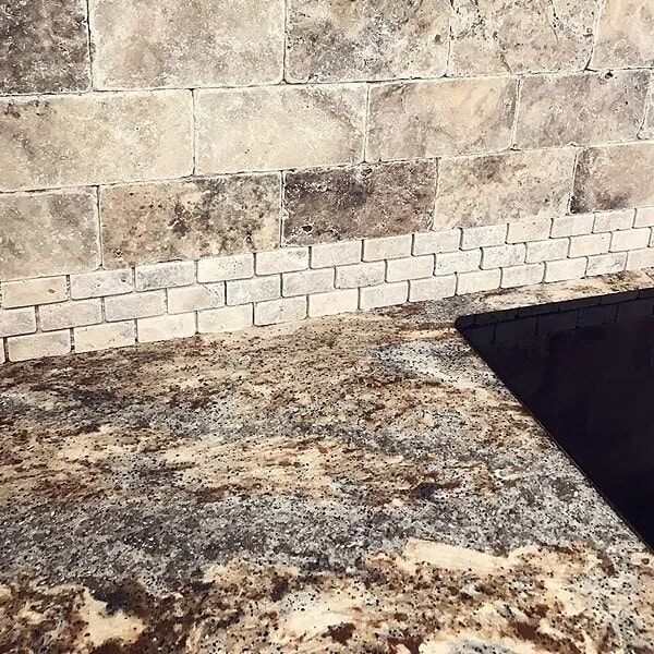 Natural stone backsplash in Port Arthur, TX from Odile's Fine Flooring & Design