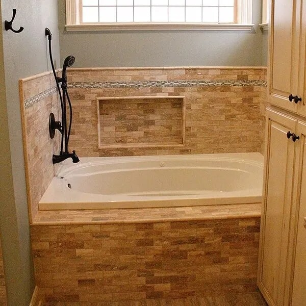 Natural tile tub surround in Beaumont, TX from Odile's Fine Flooring & Design