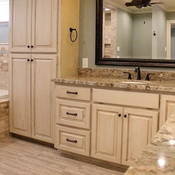 Rustic bathroom cabinetry in Orange, TX from Odile's Fine Flooring & Design