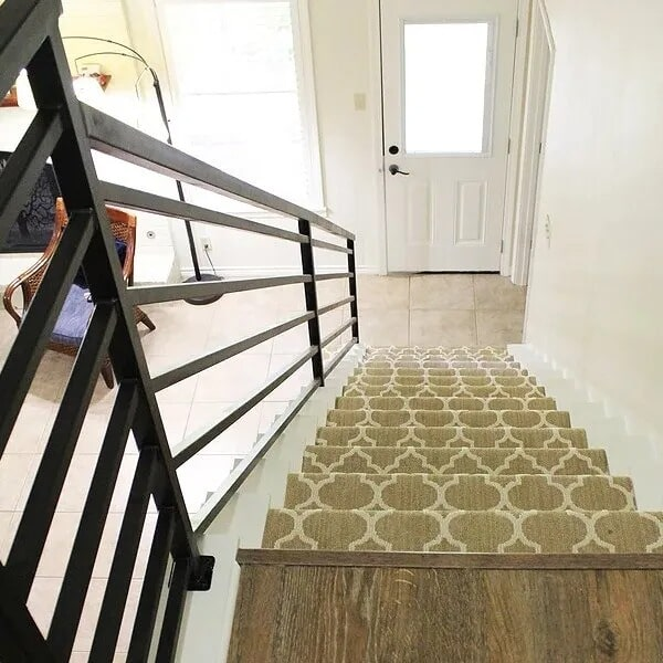 LVP stair landing in Sulphur, LA from Odile's Fine Flooring & Design