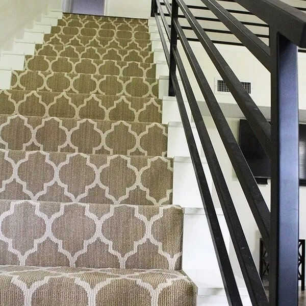 White stairs with carpet runner in Sulphur, LA from Odile's Fine Flooring & Design