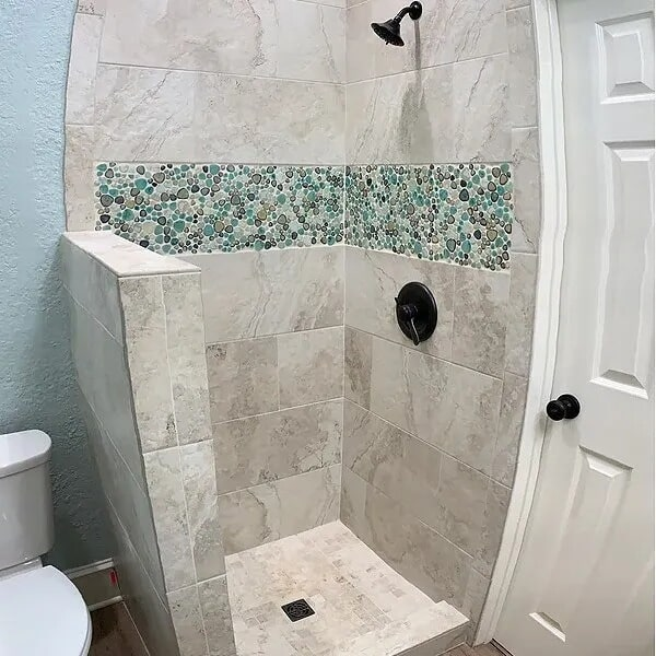 Glass tile shower accents in Orange, TX from Odile's Fine Flooring & Design