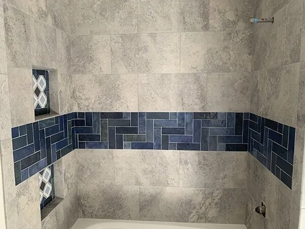 Tile accent stripe in Sulphur, LA from Odile's Fine Flooring & Design