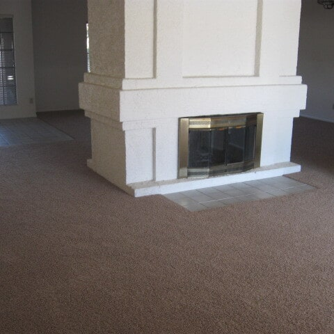 Carpet installed around fireplace in Chandler, AZ from Abel Carpet Tile & Wood