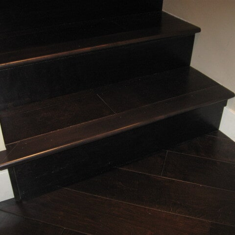 Dark hardwood stairway in Tempe, AZ from Abel Carpet Tile & Wood