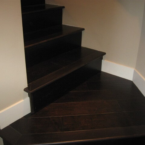 Dark wood stairs installation in Tempe, AZ from Abel Carpet Tile & Wood