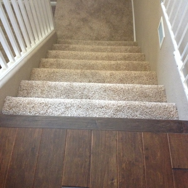Carpeted stairs with hardwood landing in Tempe, AZ from Abel Carpet Tile & Wood