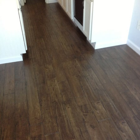 Dark laminate flooring installation in Gilbert, AZ from Abel Carpet Tile & Wood