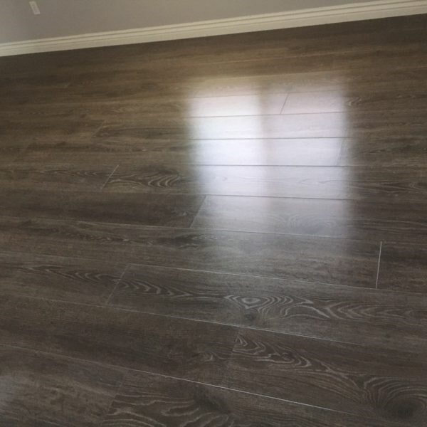 Dark gray tone laminate flooring in Chandler, AZ from Abel Carpet Tile & Wood
