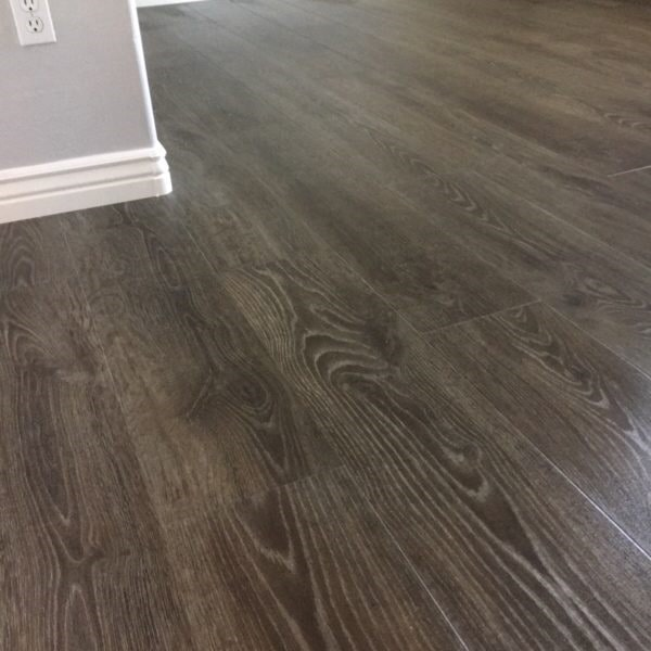 Gray laminate flooring installation in Queen Creek, AZ from Abel Carpet Tile & Wood