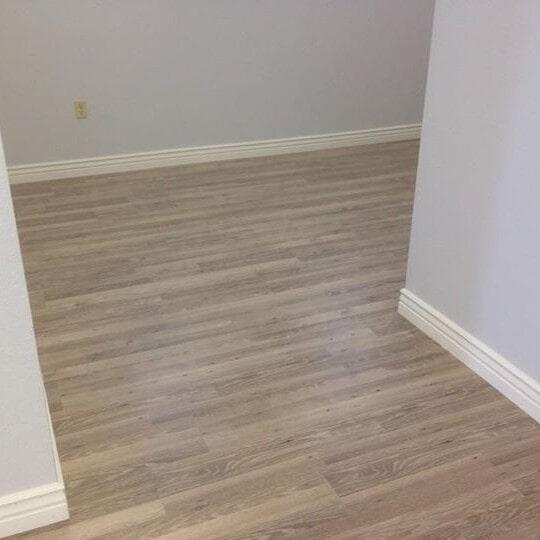 Light gray tone laminate flooring in Tempe, AZ from Abel Carpet Tile & Wood