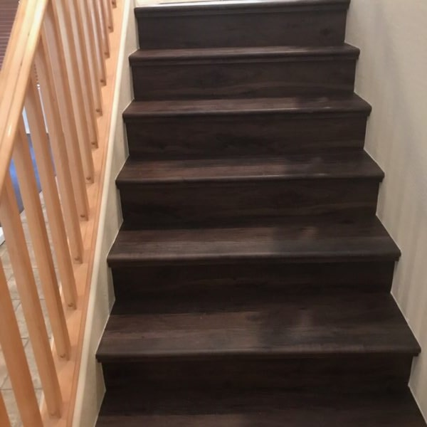 Dark vinyl plank stairway in Tempe, AZ from Abel Carpet Tile & Wood