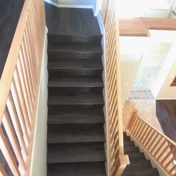 Dark luxury vinyl stairway installation in Gilbert, AZ from Abel Carpet Tile & Wood