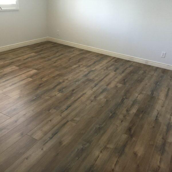 Gray tone luxury vinyl flooring in Tempe, AZ from Abel Carpet Tile & Wood
