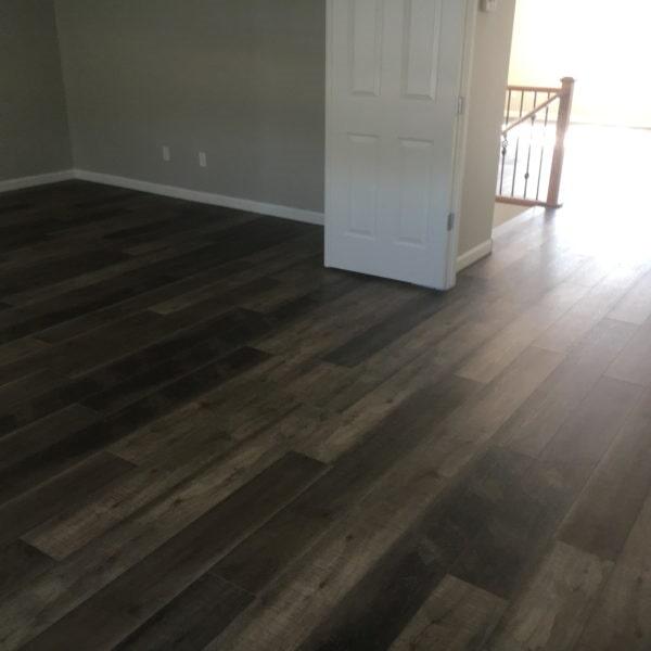 Natural dark vinyl plank flooring in Chandler, AZ from Abel Carpet Tile & Wood