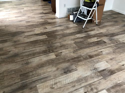 Gray tone hardwood flooring in Romeoville, IL from Marchio Tile & Carpet Inc.