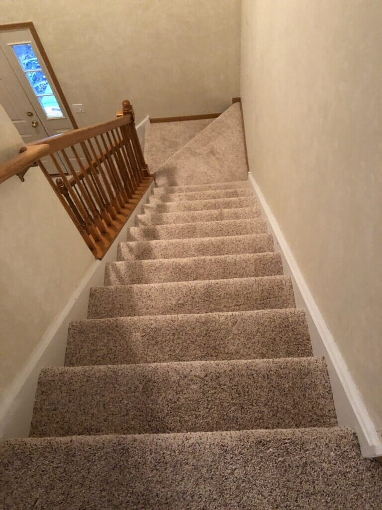 Carpeted stairway installation in Homer Township, IL from Marchio Tile & Carpet Inc.