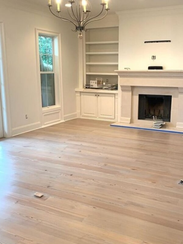 Light tone hardwood installation in Covington, LA from Ron-Del Flooring Services Inc.