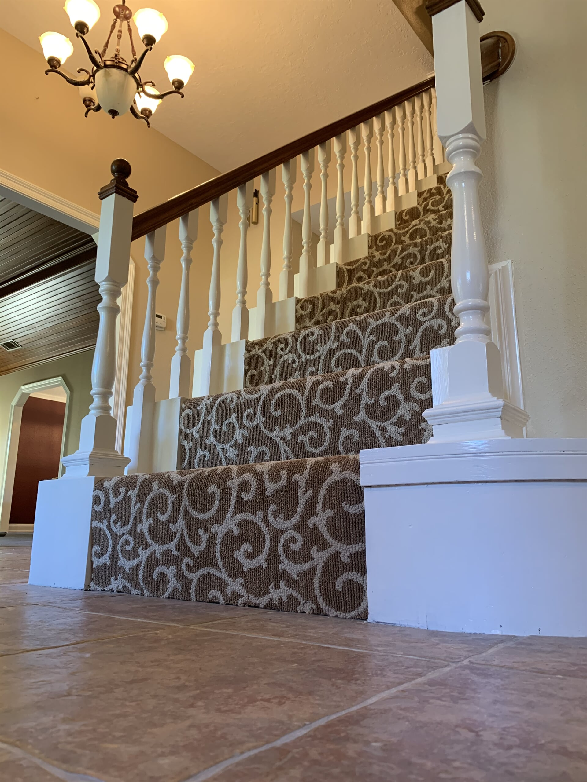 Ornate stair carpet in Vidor, TX from Odile's Fine Flooring & Design