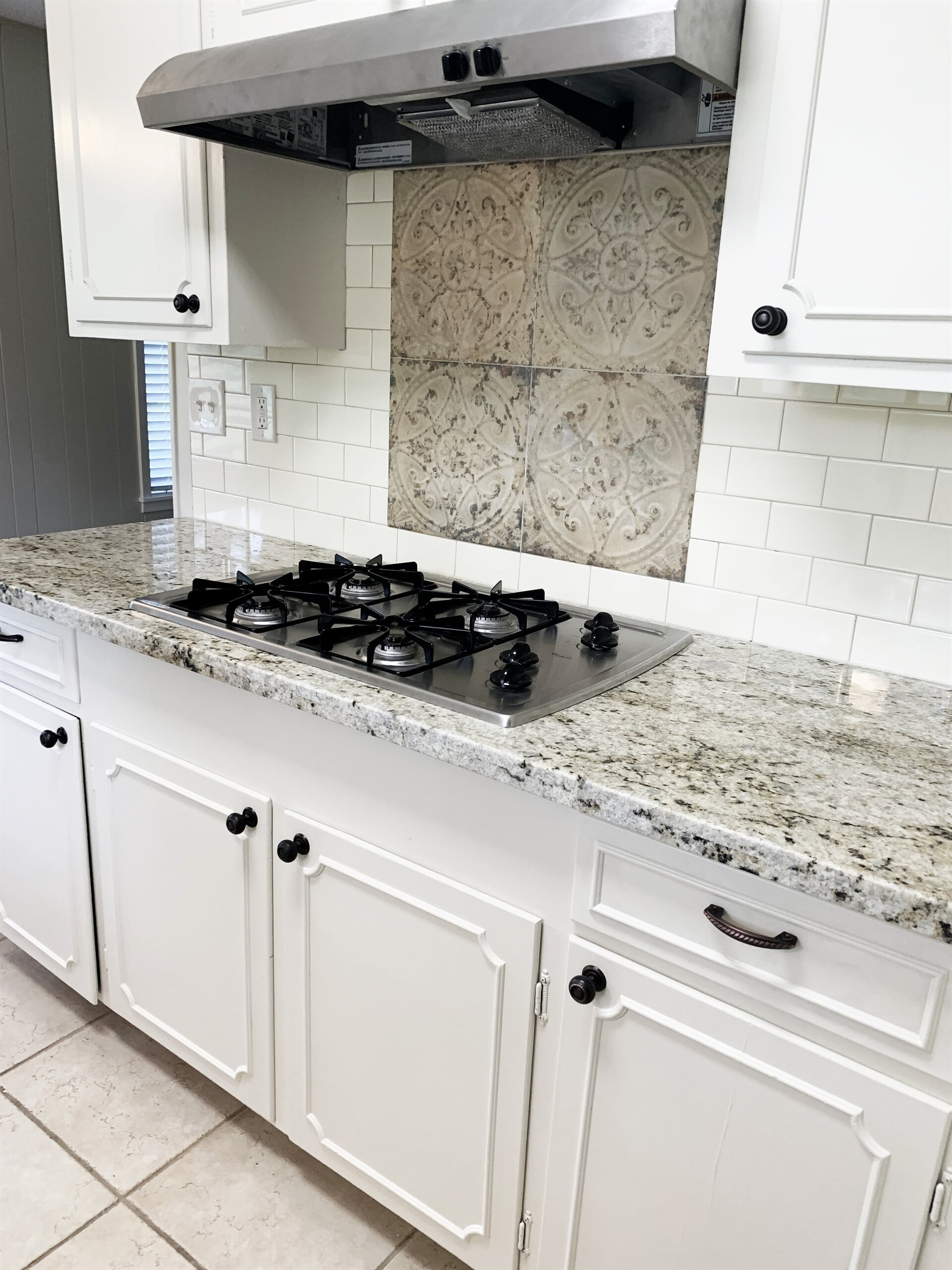 Custom backsplash piece in Port Neches, TX from Odile's Fine Flooring & Design