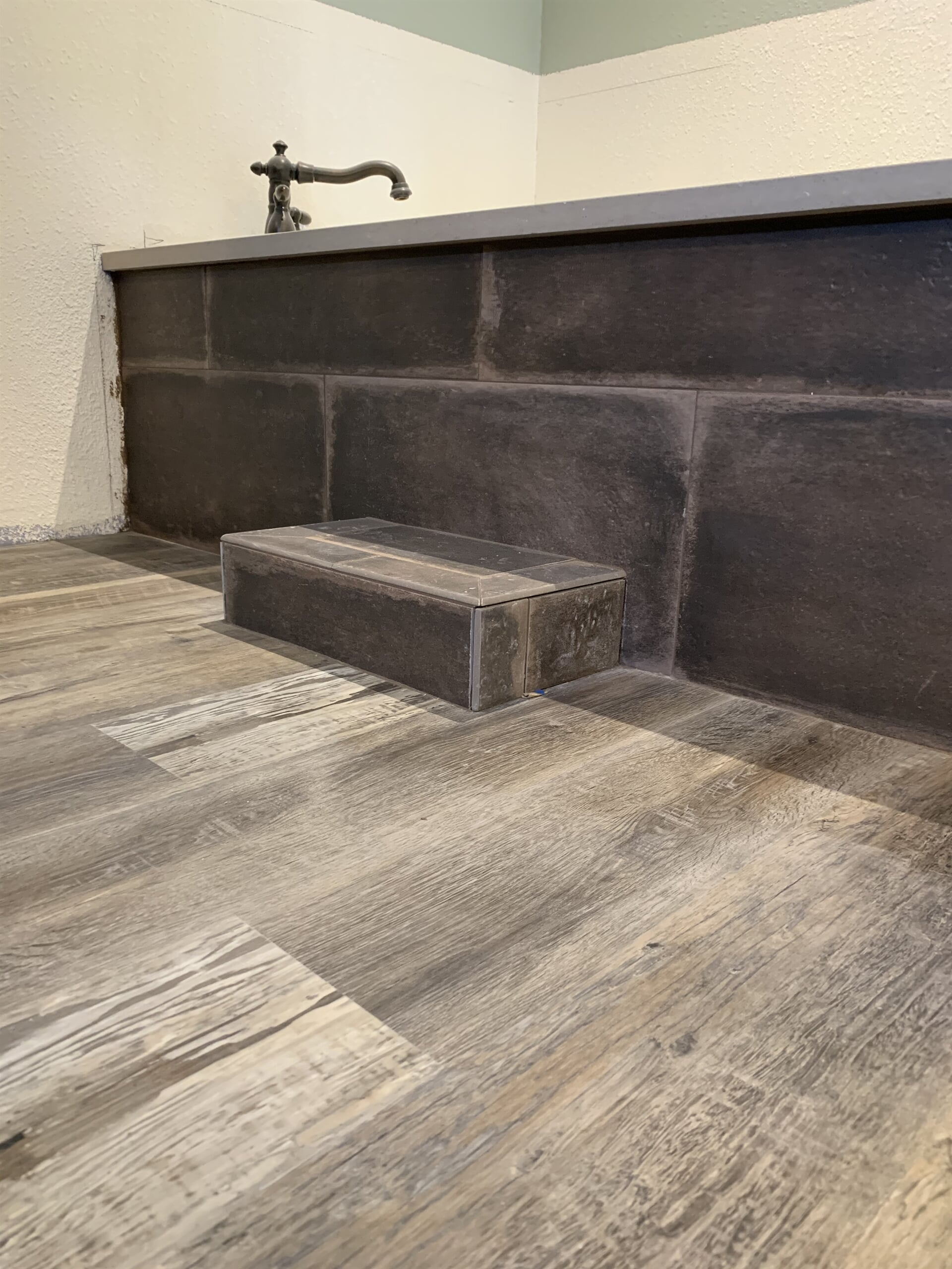 Rustic tub surround in Port Neches, TX from Odile's Fine Flooring & Design