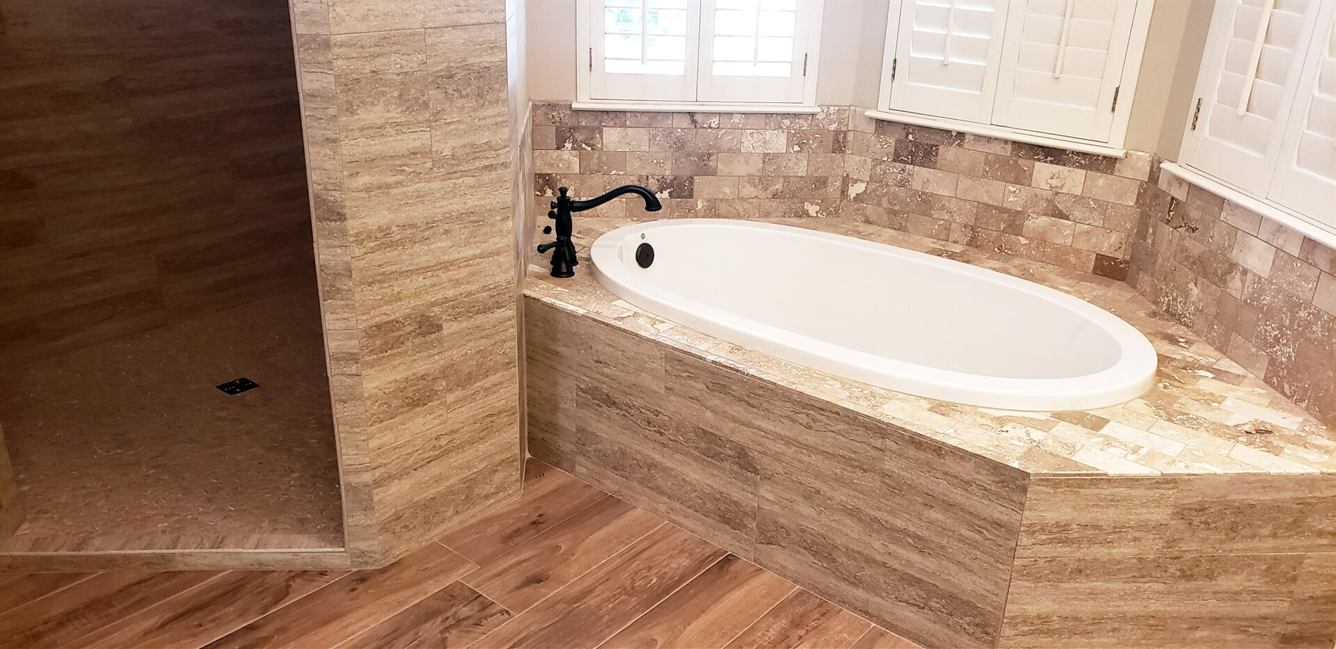 Tile tub surround in Beaumont, TX from Odile's Fine Flooring & Design