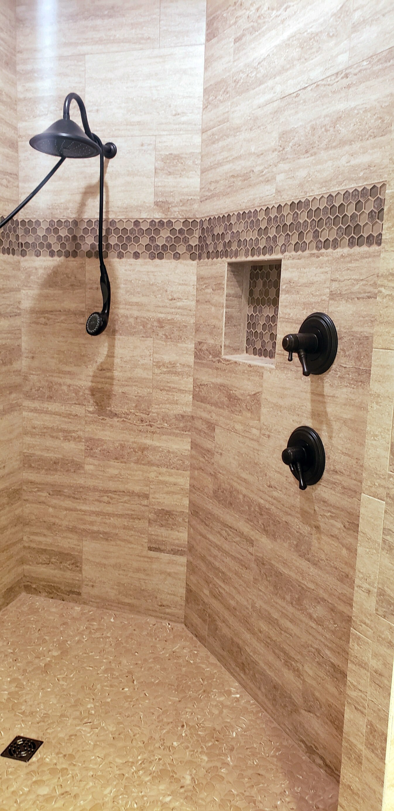 Black shower hardware in Orange, TX from Odile's Fine Flooring & Design