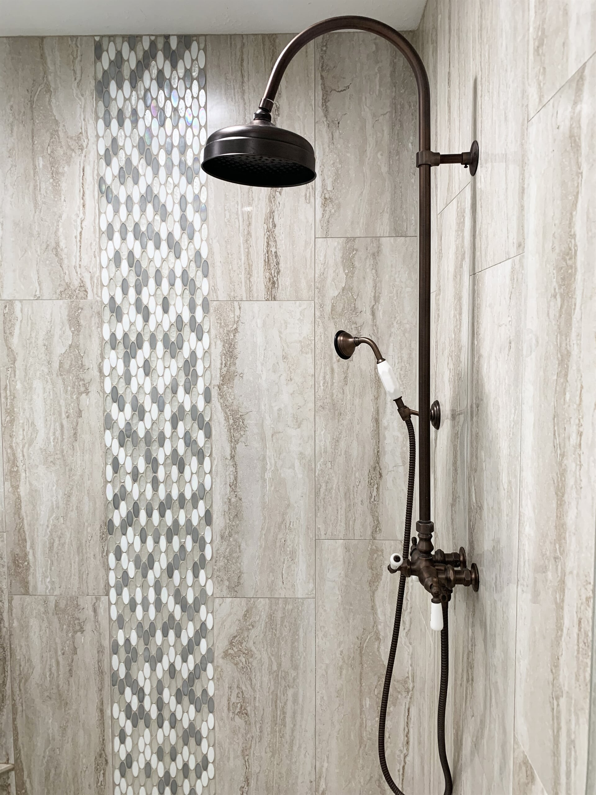 Glass tile shower accents in Vidor, TX from Odile's Fine Flooring & Design