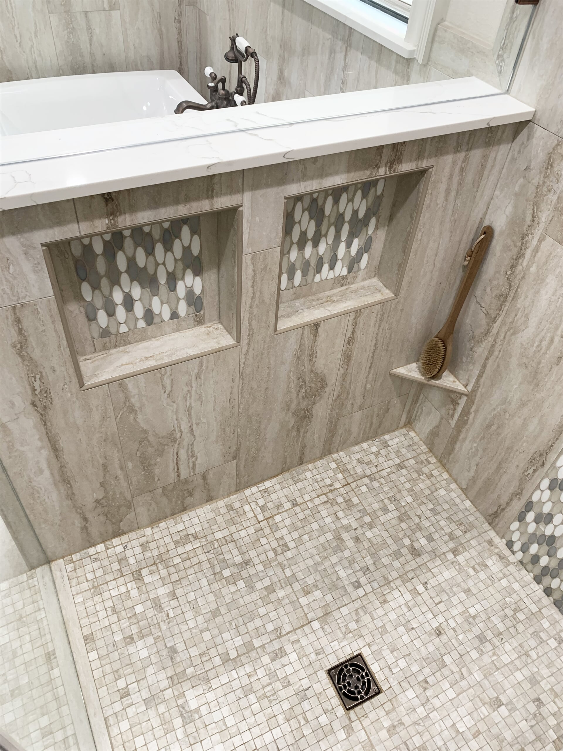 Custom shower shelving in Port Neches, TX from Odile's Fine Flooring & Design