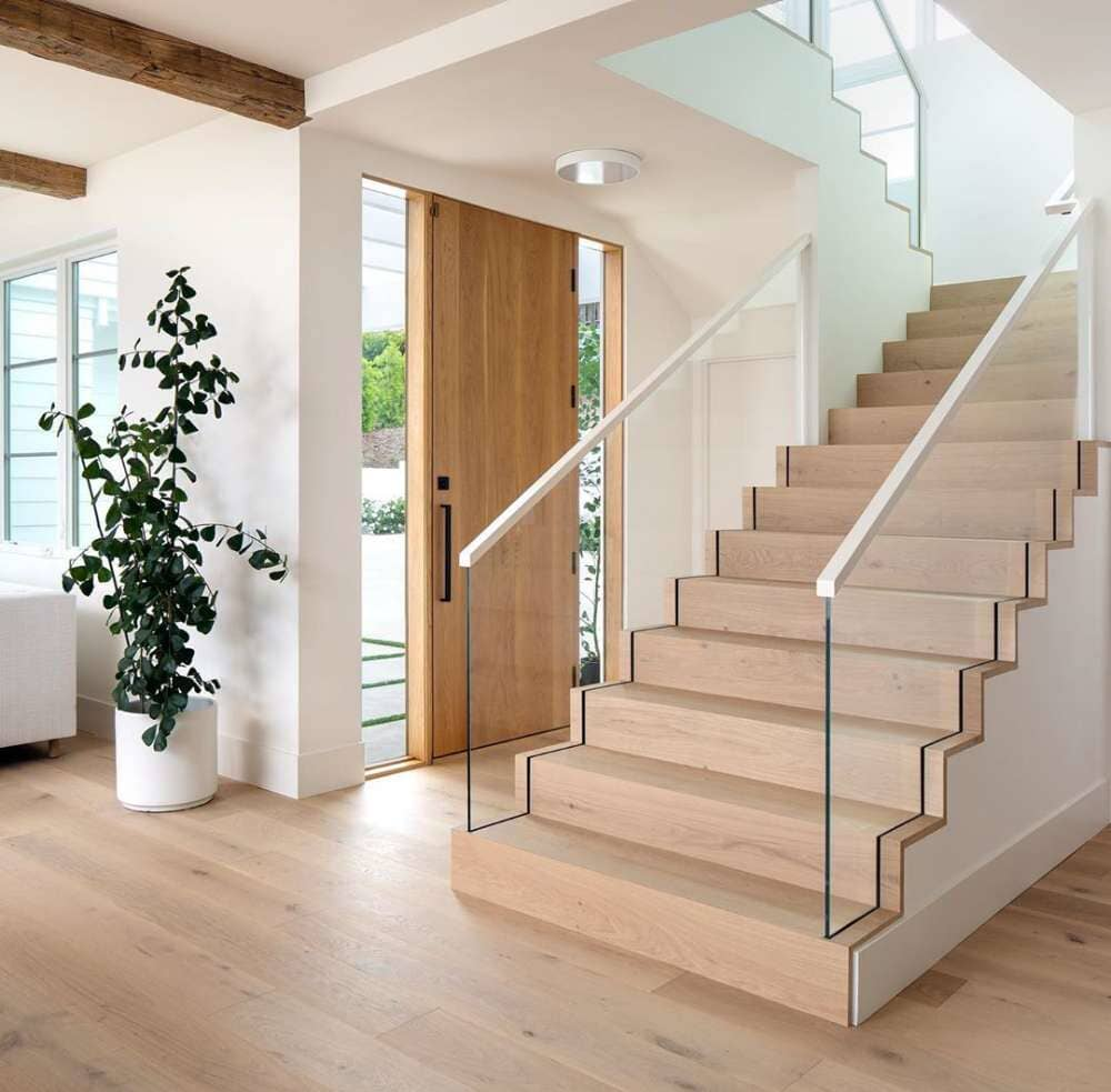 Glass stair railing with light tone hardwood floors available in Bridgeport, CT