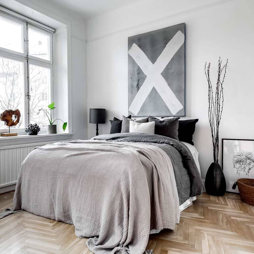 Modern monochromatic master bedroom with herringbone hardwood available in Stamford, CT