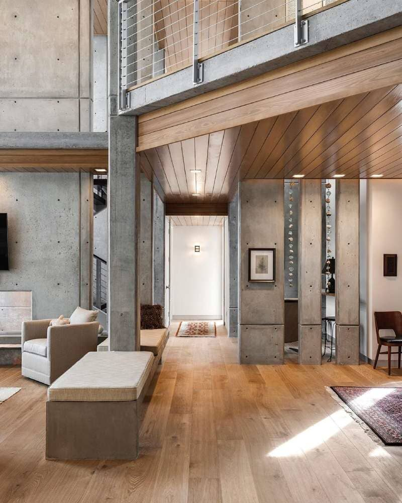 Industrial home design with lots of concrete and natural wood floors available in Stamford, CT