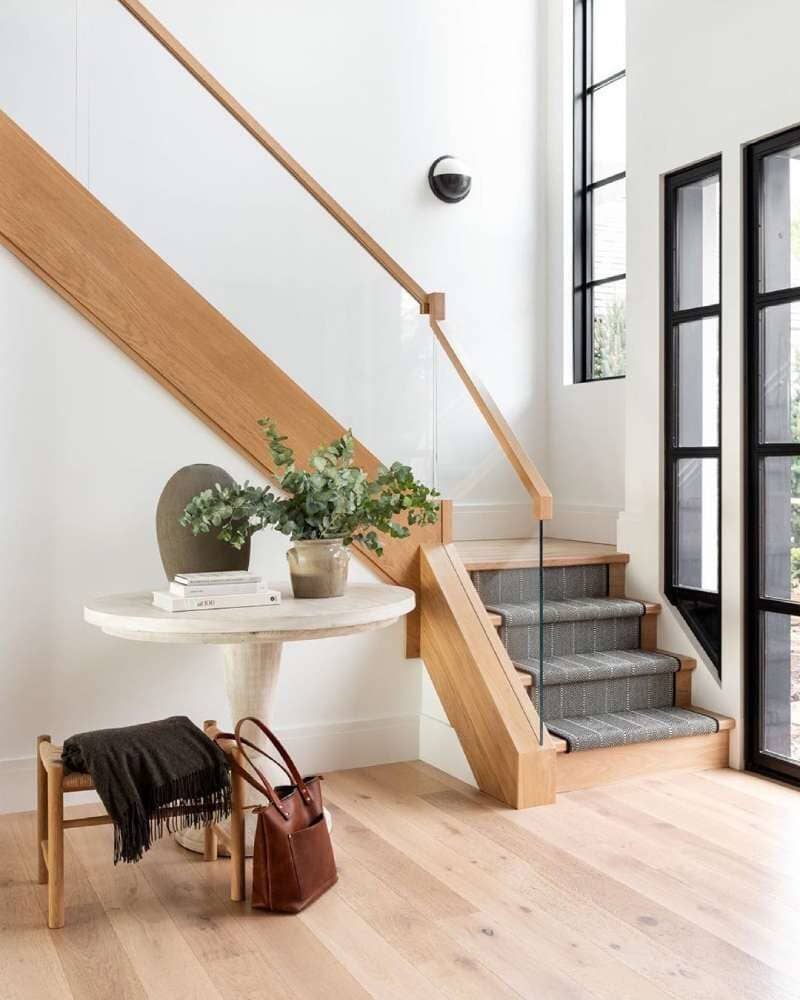 Modern stairway with invisible railing and light tone wood available in Bridgeport, CT